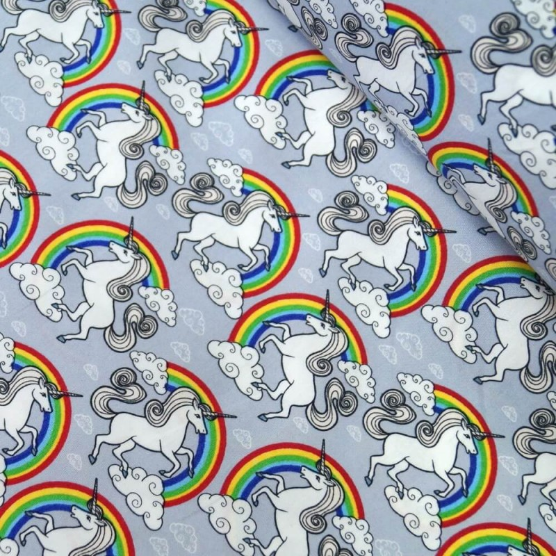 100% Cotton Poplin Fabric Proud & Beautiful Unicorns in a Cloudy Rainbow Sky Silver