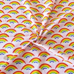 Polycotton Fabric Bright Rainbows and Clouds in the Sky Pride Rainbow Pink